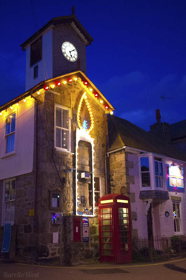 [Mousehole Clock at Night with Christmas Candle]