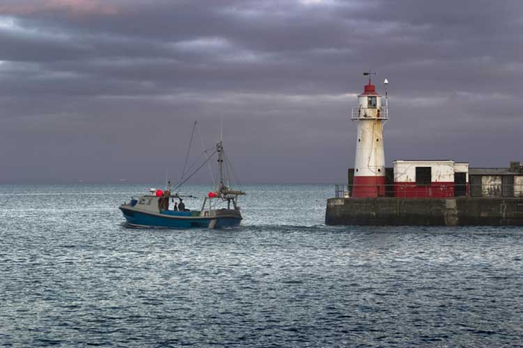 [Newlyn Harbour Lighthouse with Fishing Boat]