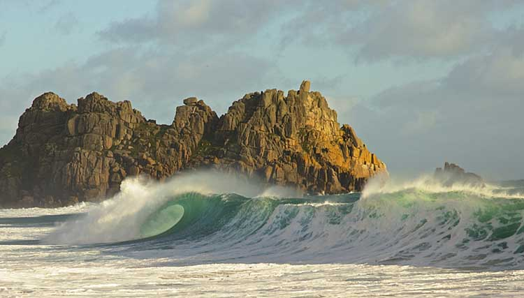 [Porthcurno, Cornwall - Breaking Wave with Green Barrel at Logan Rock]