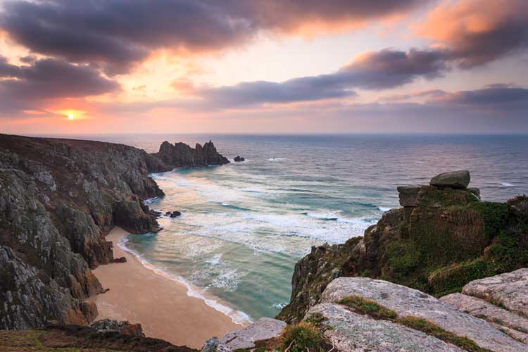[Porthcurno - Sunrise over Pedn Vounder Beach and Logan Rock]